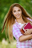 Smiling young woman with books Stock Photography