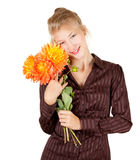Smiling young woman with bouquet of dahlias Stock Photo