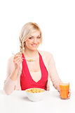 A smiling young woman at breakfast Stock Image