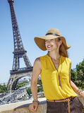 Smiling young woman in bright blouse in Paris, France Stock Photo