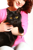 Smiling young woman with a British cat isolated on white backgro. Portrait of smiling young woman with black British cat Stock Photos