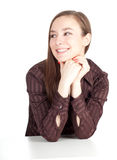 Smiling young woman in brown blouse Stock Image