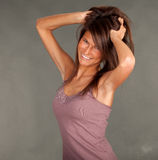 Smiling young woman in brown blouse Stock Photo