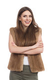 Smiling Young Woman In Brown Fur Vest Royalty Free Stock Image