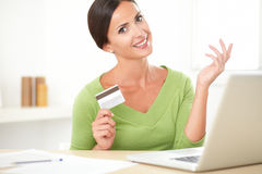 Smiling young woman buying on e-commerce from home Royalty Free Stock Image