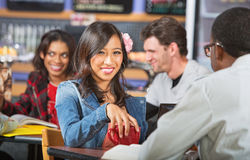 Smiling Young Woman in Cafe Stock Photo