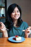 Smiling young woman with a cake Royalty Free Stock Images