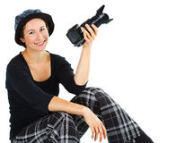 Smiling young woman with a camera Stock Photo