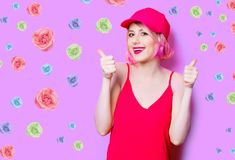 Smiling young woman in cap with roses royalty free stock photo