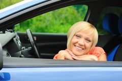 Smiling young woman in the car Stock Photo