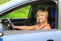 Smiling young woman in the car Royalty Free Stock Photos