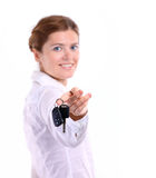 Smiling young woman with car key Stock Image