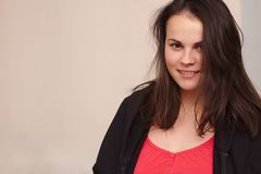 smiling young woman in casual clothes. Portrait plus size model on background stock photo