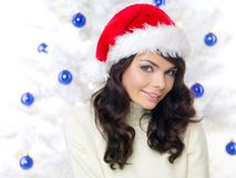 Smiling young woman celebrating Christmas Stock Photo