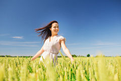 Smiling young woman on cereal field Stock Photography