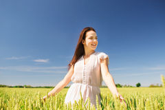 Smiling young woman on cereal field Royalty Free Stock Photo