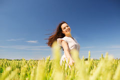 Smiling young woman on cereal field Stock Images
