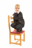 Smiling young woman on the chair Stock Photos