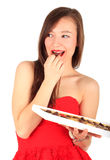 Smiling young woman with chocolate box Royalty Free Stock Images