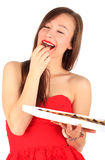 Smiling young woman with chocolate box Stock Images