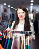 Smiling young woman choosing clothes Stock Photos
