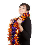 Young woman with christmas decoration chain Royalty Free Stock Photography