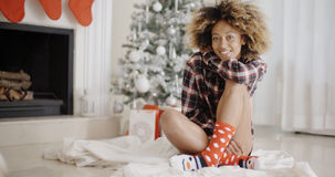 Smiling young woman in a Christmas living room Stock Photography