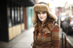 Smiling young woman in the city Royalty Free Stock Images