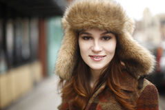Young woman in fur hat Royalty Free Stock Photos
