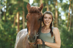 Smiling young woman close-up with horse Stock Photo