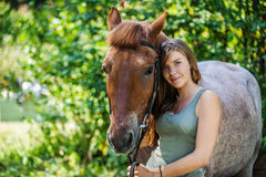 Smiling young woman close-up with horse Royalty Free Stock Images