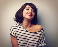 Smiling young woman with closed eyes laughing with short hair Royalty Free Stock Photo