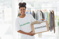 Smiling young woman with clothes donation Stock Photography
