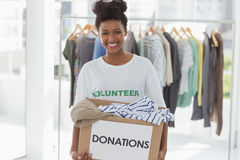 Smiling young woman with clothes donation Stock Photos