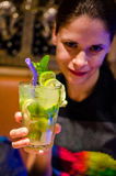 Smiling young woman with cocktail stock photo