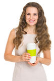 Smiling young woman with coffee cup Royalty Free Stock Photo