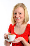Smiling young woman with a coffee cup Stock Photography