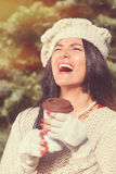 Smiling  young woman with coffee to go outdoors Stock Photos