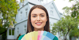 Smiling young woman with color swatches Royalty Free Stock Photo