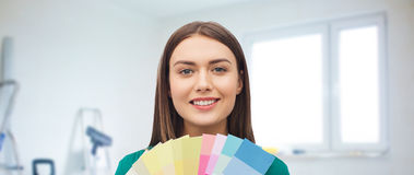 Smiling young woman with color swatches Stock Image