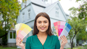 Smiling young woman with color swatches Stock Photography