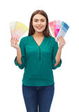 Smiling young woman with color swatches Royalty Free Stock Photography