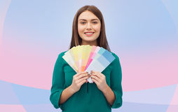 Smiling young woman with color swatches Stock Images