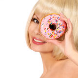 Smiling young woman with colorful donut isolated Royalty Free Stock Photo