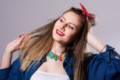 Smiling young woman in colorful dress Stock Photos
