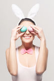 Smiling young woman with colorful easter eggs Royalty Free Stock Photography