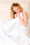 Smiling young woman covering with blanket Royalty Free Stock Images