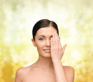 Smiling young woman covering face with hand Royalty Free Stock Photos