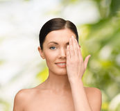 Smiling young woman covering face with hand Royalty Free Stock Images