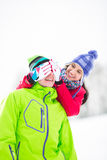 Smiling young woman covering man's eyes in winter Stock Photography